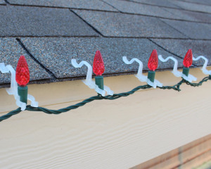 C6 LED Christmas lights installed using LED All In One Clips. Easy to install option for asphalt shingle roofs. Coutesy of ChristmasDesigners.com