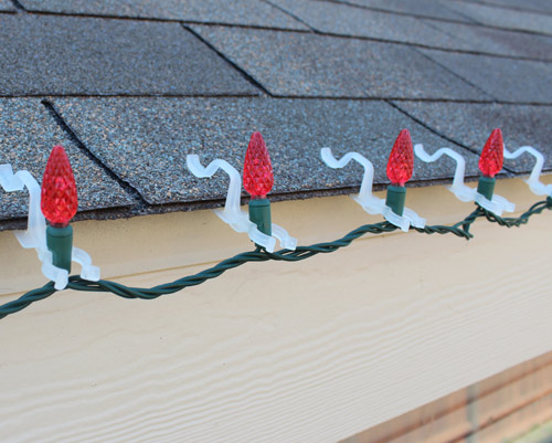 C6 LED Christmas lights installed using LED All In One Clips. Easy to  install option - How To Professionally Hang Holiday Lights EClean Magazine